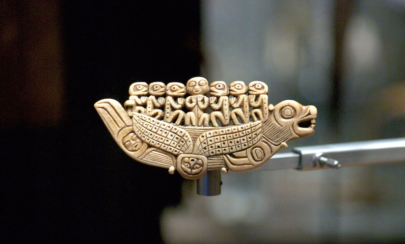 A tiny Tlingit sakaat shama's amulet, shaped like a sea lion canoe in which seven spirits ride, is displayed in a Smithsonian Arctic Studies Center exhibition. The SASC features artifacts from all major Alaska Native groups. (U.S. Air Force photo/David Bedard)