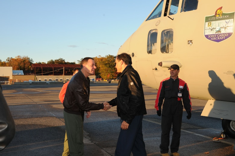 Colonel Frank Detorie (left), Commander, 103rd Airlift Wing, greets representatives of Alenia Aeronautica as they arrive in a C27J Spartan to Bradley Air National Guard Base in East Granby, Conn. on Thursday, Oct. 21, 2010.  The visit by the Italian manufacturer, which featured a familiarization tour of the aircraft, afforded the Flying Yankees of the 103rd Airlift Wing an opportunity to experience its future mission capabilities first hand.  (U.S. Air Force photo by Tech. Sgt. Erin E. McNamara)