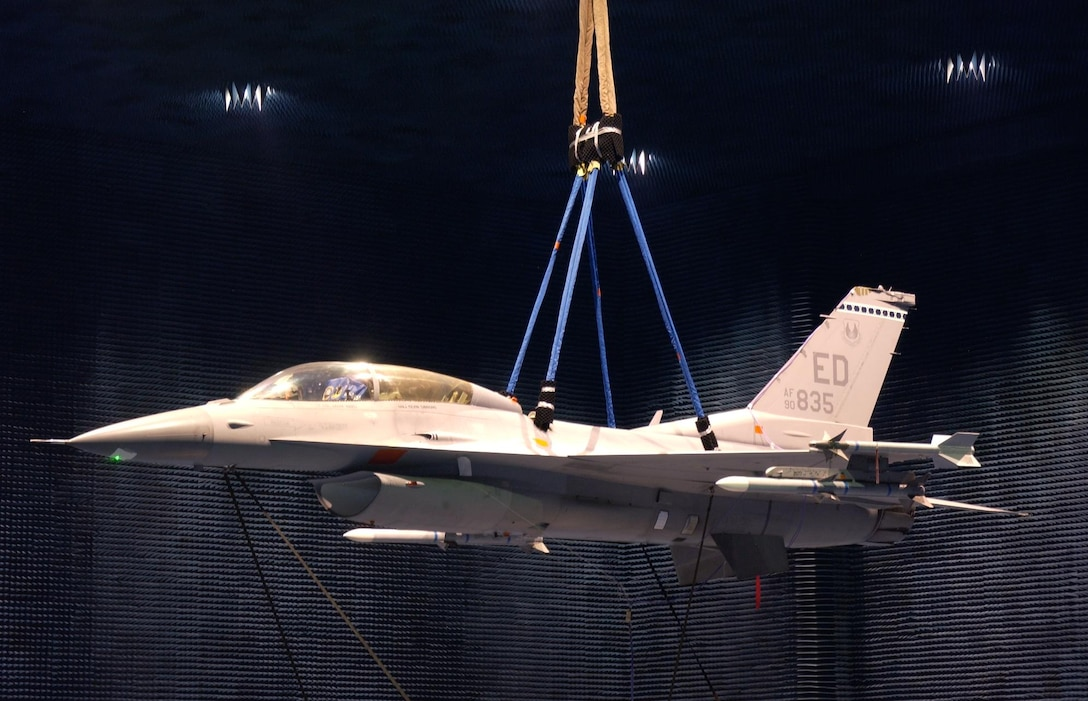 An Edwards F-16 hangs in the Benefield Anechoic Facility to undergo testing. The BAF is the largest anechoic facility in the world. (Air Force photo)