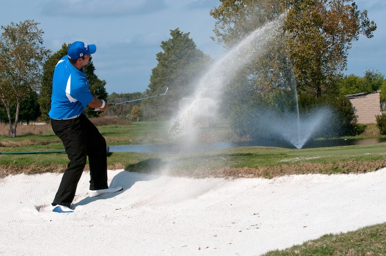 LANGLEY AIR FORCE BASE, Va. – U.S. Air Force golfer Thomas Whitney, of Vandenberg Air Force Base, drives the ball from a sand bunker during the Air Force Golf Championship Oct. 19. Air Force personnel from around the world competed in the tournament to advance on to the Armed Forces Golf Championship. At the conclusion of the Armed Forces competitions, the best players are selected to represent the U.S. at International Military Sports Competitions hosted worldwide or at U.S. national championships. (U.S. Air Force photo/Eric Deagle)