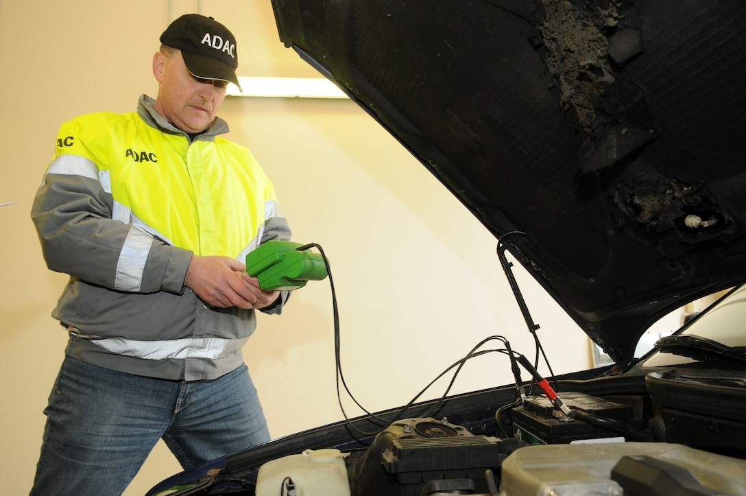 SPANGDAHLEM AIR BASE, Germany – Herbert Fuss, ADAC representative, tests the voltage of a car battery during a winter check Oct. 23. ADAC, a German auto club similar to the American Automobile Association, visited the base and partnered with the 52nd Fighter Wing Safety Office to perform free inspections on privately owned vehicles to identify potential hazards before winter driving conditions arrive. (U.S. Air Force photo/Staff Sgt. Benjamin Wilson)