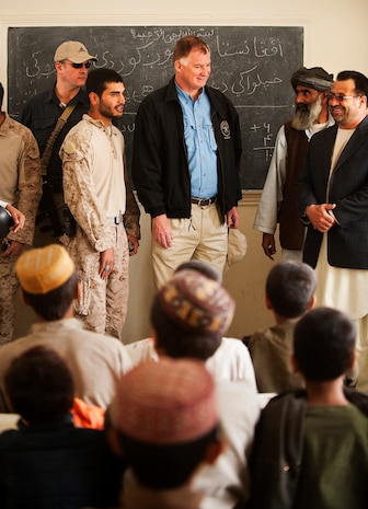 William J. Lynn III, the deputy secretary of defense, visits a classroom at Khalaj High School during a tour of Nawa, Afghanistan, Oct. 28, 2010. Lynn visited Forward Operating Base Jaker and toured the surrounding area in Nawa to note progress by the Nawa Government and coalition forces.
