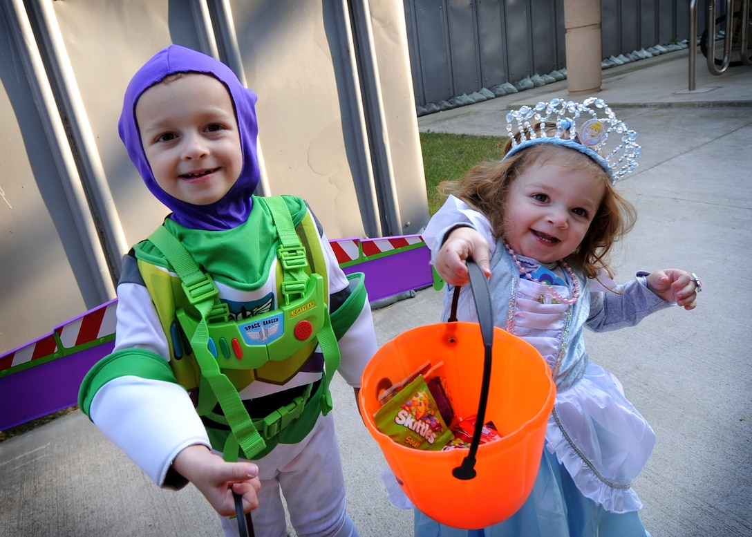 Benjamin and Abigael Springer show off their candy during the second annual Osan Trick-or-Treat Bash Oct. 28.  Children collected candy through a safe maze of offices and booths from military personnel and base organizations. The Trick-or-Treat Bash was followed by a costume contest at the Officers club. (U.S. Air Force Photo/Senior Airman Evelyn Chavez)