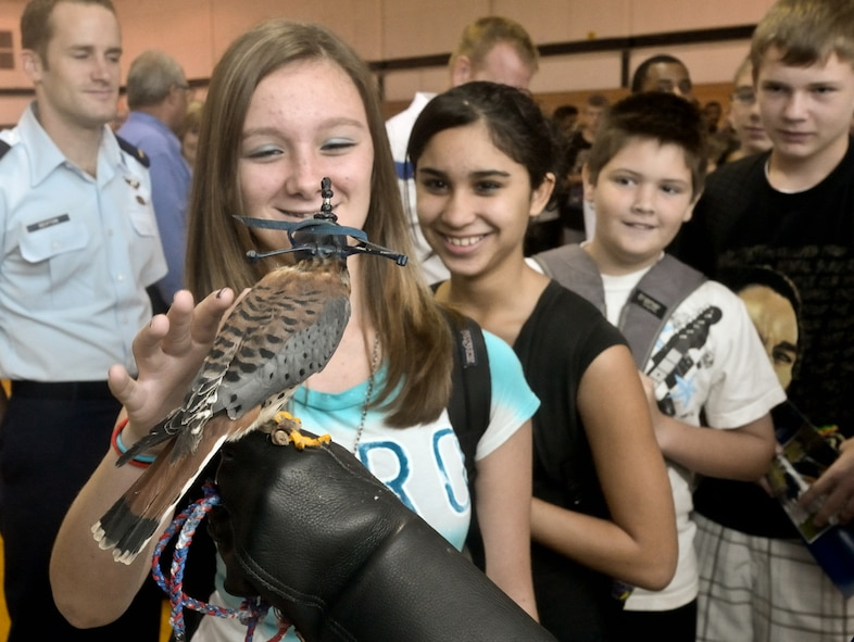 """Students were able to individually meet Cadet 3rd Class Danielle Cortez and  """"Buzz,"""" a kestrel falcon who had the attention of the students and faculty of Lyndon B. Johnson Middle School Oct. 28, 2010, in Melbourne, Fla. (U.S. Air Force photo/Lance Cheung)"""