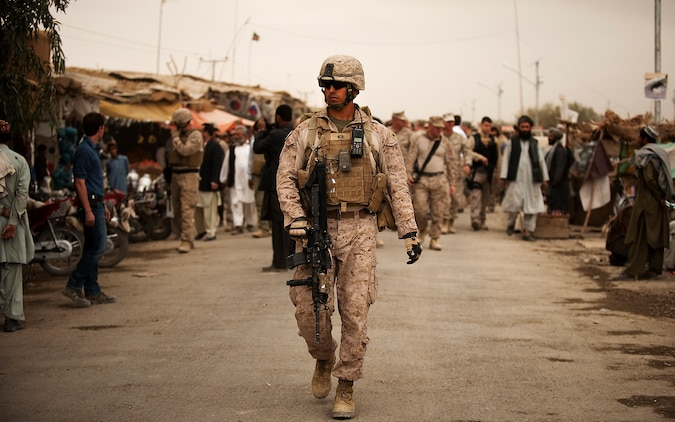 Navy Petty Officer 3rd Class Jorge Medina, a corpsman with Jump Platoon, 3rd Battalion, 3rd Marine Regiment, provides security while escorting the deputy secretary of defense through the Nawa Bazaar in Helmand province, Afghanistan, Oct. 28, 2010. Jump Platoon's primary mission is to provide security for the battalion commander and transport him throughout 3/3's battle space, but the platoon performs a variety of tasks from providing supplementary security and running vehicle checkpoints, to masonry and gardening.