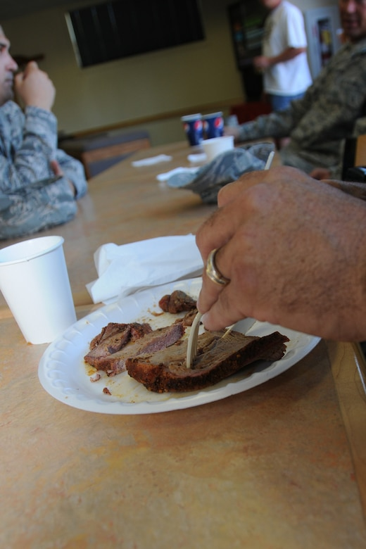 A member of the 173rd Fighter Wing cuts into a piece of tender tri-tip during the Wing End of Year celebration at Kingsley Field, Ore. Oct. 1, 2010.  (RELEASED, U.S. Air Force Photo by Tech. Sgt. Jefferson Thompson)