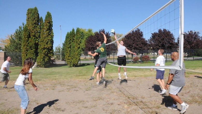 The end of Fiscal Year 2010 celebration included smoked tri-tip and baked potates at the dining facilty, and after lunch a group of health conscious Airmen headed to the sand volleyball court to burn off their lunch. (U.S. Air Force photo by Tech Sgt. Jefferson Thompson, Released)