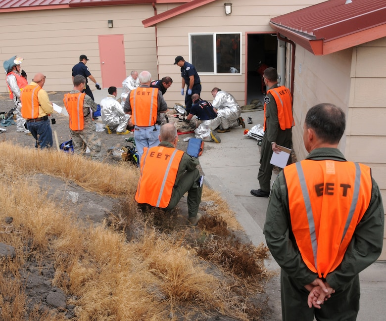 During the unit compliance inspection the AETC Inspector General team evaluates the 173rd Fighter Wing?s disaster response, Sept. 17. The exercise simulated an aircraft crash and it?s aftermath, including a fire.  (U.S. Air Force photo by Tech. Sgt. Jefferson Thompson, Release).