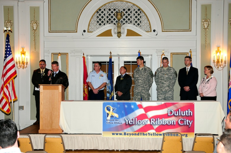 Lieutenant Colonel Jon S Safstrom speaks at the Yellow Ribbon ceremony held on Oct. 28, 2010 at the Greysolon Plaza in Duluth, Minn.  The event was held to celebrate Duluth's recognition as a Yellow Ribbon City from the culmination of work completed by the Beyond the Yellow Ribbon Steering Committee led by co-chairs Richard Dumancas and Jennifer Kuhlman, 148th Fighter Wing Airman and Family Readiness Program Manager.  (U.S. Air Force photo by SSgt Donald Acton)
