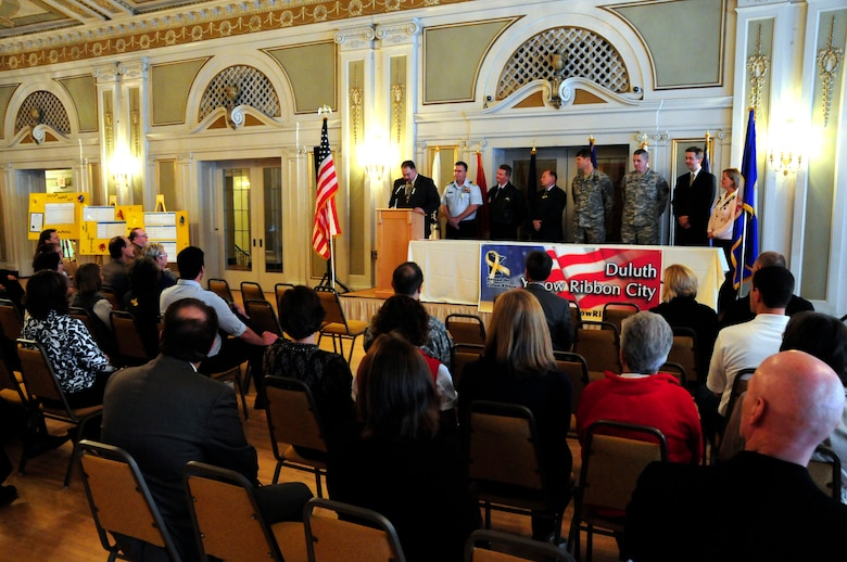 Richard C. Dumancas of the St Louis County Veterans Service Office, starts off the Yellow Ribbon ceremony held on Oct. 28, 2010 at the Greysolon Plaza in Duluth, Minn.  The event was held to celebrate Duluth's recognition as a Yellow Ribbon City from the culmination of work completed by the Beyond the Yellow Ribbon Steering Committee led by co-chairs Richard Dumancas and Jennifer Kuhlman, 148th Fighter Wing Airman and Family Readiness Program Manager.  (U.S. Air Force photo by SSgt Donald Acton)