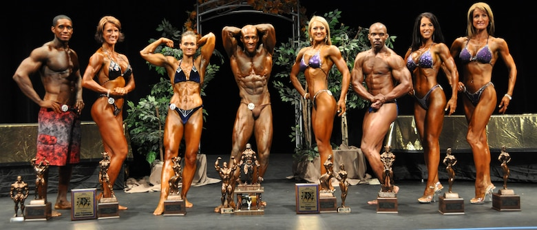 Staff Sgt. Eric Schmidt (center), 27th Special Operations Civil Engineer Squadron, stands among other winners after winning first place in his division and first place overall during the Organization of Competitive Bodybuilders Arizona Natural Bodybuilding and Figure Pro Qualifier Competition August 28. By winning first place Sergeant Schmidt was awarded a Pro-card allowing him to go and compete in International Fitness and Physique Association professional competitions. (Courtesy photo)