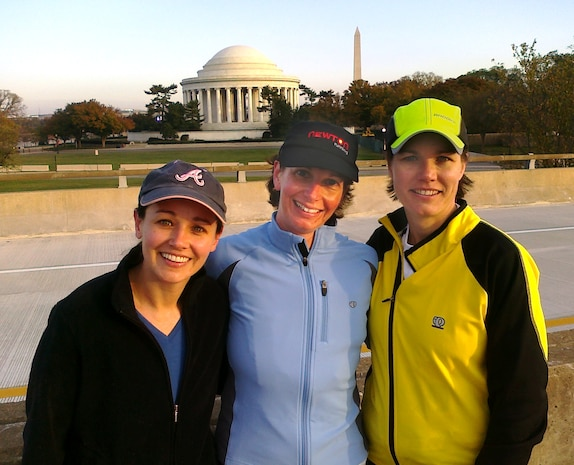 Captain Pauleen Stevens (center) of Life Cycle Logistics stops during the Marine Corps Marathon's 10K race to pose in front of the Thomas Jefferson Memorial with Quantico friends Captain Susan Kilpatrick (left) and Major Marlene Hunt.