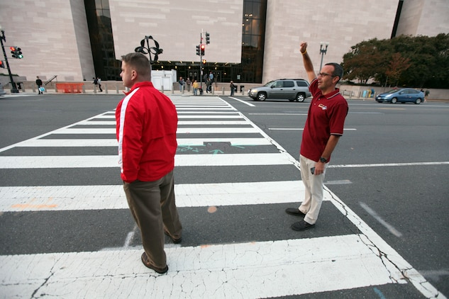 Joe Puleo, head coach of the U.S. Marine Corps' running team, attempts to hail a cab Oct. 30, on his way to the annual pasta dinner held the night before the Marine Corps Marathon. Puleo, has coached the Marine Corps' team for the past five marathons. The Challenge Cup, held for more than 30 years, pits the top three finishers of the U.S. Marines against the top three finishers of the Royal British Marines and Navy team. The lowest combined time wins the cup. The Brits had won 10 in a row beofre Puleo came aboard, however, since his arrival the U.S. Marines have won three of the five. Including this year's cup in the 35th annual Marine Corps Marathon.