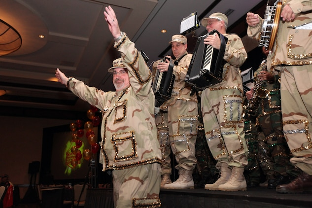 Pete Broomall, of the Broomall Stringband performs for the runners of the 35th annual Marine Corps Marathon at the annual pasta dinner held Oct. 30, the night before the race. Broomall's grandfather started the band in 1930, and it's the first year they've performed at the dinner.