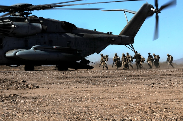 Marines with E Company, 2nd Battalion, 7th Marine Regiment, board a CH-53E Super Stallion during the final exercise of the recent Weapons and Tactics Instructor course at Auxiliary Airfield 6 on the Barry M. Goldwater Range in Ariz., Oct. 30, 2010. Operation War Wagon, tested the skills learned by the WTI students and included the participation of approximately 250 infantry Marines from the battalion.::r::::n::