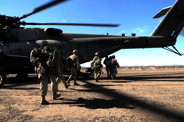 Marines with E Company, 2nd Battalion, 7th Marine Regiment, board a CH-53E Super Stallion during the final exercise of the recent Weapons and Tactics Instructor course at Auxiliary Airfield 6 on the Barry M. Goldwater Range in Ariz., Oct. 30, 2010. Operation War Wagon tested the skills learned by the WTI students and included the participation of approximately 250 infantry Marines from the battalion. ::r::::n::::r::::n::