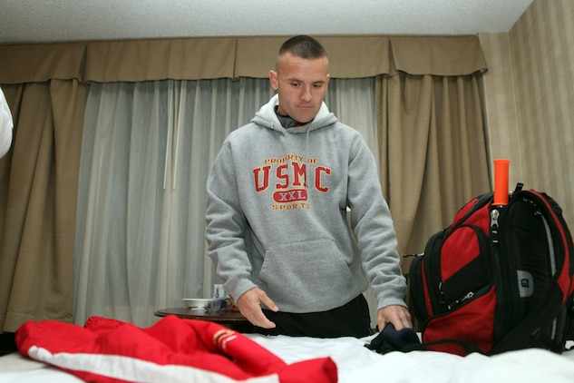 """Capt. Richard Jennings, of the All-Marine running team, packs his gear and completes any final preparations before leaving the teams' hotel for the 35th annual Marine Corps Marathon at around 6 a.m., Oct 31. """"It's the calm before the storm,"""" Jennings said just before leaving the hotel."""
