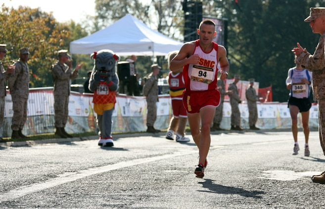 Capt. Richard Jennings approaches the finish line of the 35th annual Marine Corps Marathon Oct. 31, 2010. Jennings helped the U.S. Marine running team defeat the Royal British Marines and Navy team in the Challenge Cup by running his personal best time of 2 hours, 36 minutes and 20 seconds. The Challenge Cup has existed for more than 30 years and pits the top three finishers from each team against each other by combining their times. The team with the lowest total wins the cup.