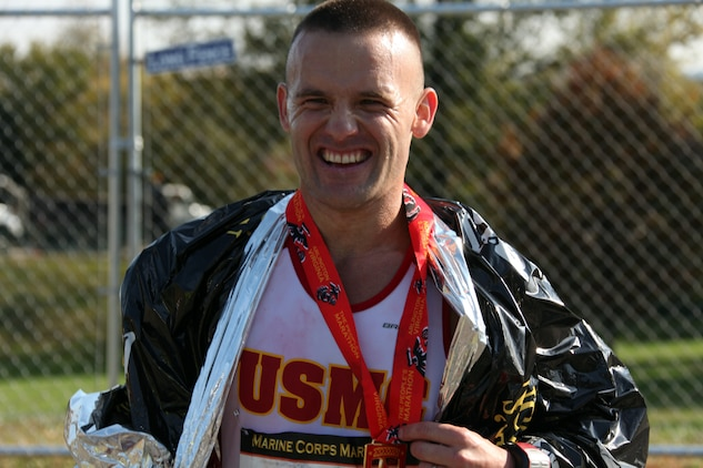 """Capt. Richard Jennings smiles after being informed of the U.S. Marines victory over the Royal British Marines and Navy team in the Challenge Cup during the 35th annual Marine Corps Marathon Oct. 31, 2010. The Challenge Cup puts the top three finishers from each team against each other by combining their times. The team with the lowest total wins the cup. """"It was something we really needed to do this year,"""" Jennings said. """"It's always nice to beat the Brits."""""""