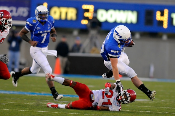 Senior running back Nathan Walker leaps over a Utah defender during the first quarter of play against Utah at Falcon Stadium Oct 30, 2010. Walker had six carries for 31 yards in the Falcons' 28-23 loss to the No. 8 Utes. (U.S. Air Force photo/Johnny Wilson)