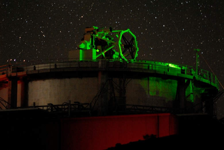 Air Force Research Laboratory's 3.6-meter, 75-ton Advanced Electro-Optical System (AEOS) telescope under laser illumination at its Directed Energy Directorate's Air Force Maui Optical and Surveillance Site, Maui, Hawaii.   The illumination resulted from the multi-wave length laser propagation experiments that were completed at over 10,000 feet and over a 90-mile path between Mauna Loa on the island of Hawaii and the Air Force site atop the extinct volcano, Haleakala, on Maui, Hawaii.      U.S. Air Force Photo by Rob Ratkowski