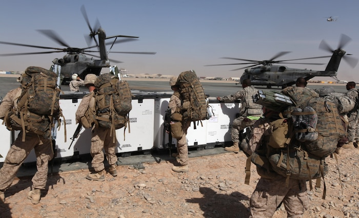 Marines from 9th Engineer Support Battalion, 3rd Marine Logistics Battalion, wait to board a CH-53E Super Stallion on the flight line here Sept. 2. The Marines were transported to Kajaki Dam by Marine Heavy Helicopter Squadron 361. HMH-361 is one of the primary personnel and cargo transport squadrons for 3rd Marine Aircraft Wing (Forward).