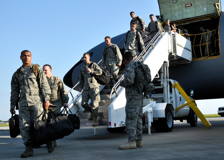 Maintainers and security forces Airmen from the 4th Fighter Wing disembark the KC-135 Stratotanker after arriving to Eglin Air Force Base Fla., Sept. 1 as part of a hurricane evacuation from Seymour Johnson AFB, N.C.  Approximately 30 F-15E Strike Eagles, three KC-135s, and 300 personnel arrived to beddown the aircraft as Hurricane Earl headed for the N.C. coast.  The 33rd Fighter Wing, a former F-15 unit now the training wing for the F-35 Lightning II, provided flightline space for the aircraft.  (U.S. Air Force photo/Samuel King Jr.)
