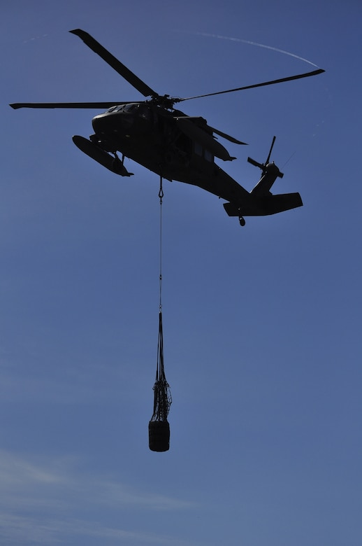 SOTO CANO AIR BASE, Honduras --  A UH-60 Blackhawk helicopter lifts cargo as part of sling load training for Army Forces here Sept. 1. ARFOR personnel conduct sling load training every other month. (U.S. Air Force photo/Martin Chahin)