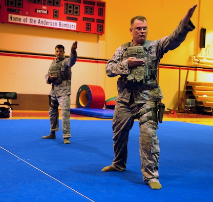ANDERSEN AIR FORCE BASE, Guam ? Members of the Andersen Combat Aikido class practice self defense at the HotSpot gym Aug. 31. Aikido is a Japanese Martial Art used to direct the momentum of an assailant against them. (U.S. Air Force photo by Airman Whitney Amstutz)