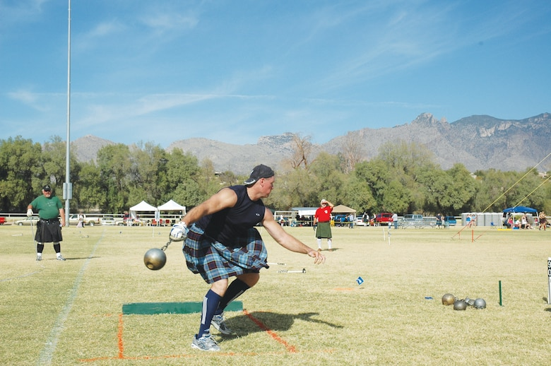 Maj. Shawn Baker, 56th Medical Group orthopedics, swings a hammer as part of a Scottish Masters Athletics International Competition even in Denver, Colorado.  Baker has been competing in the games for four years. (Courtesy photo)