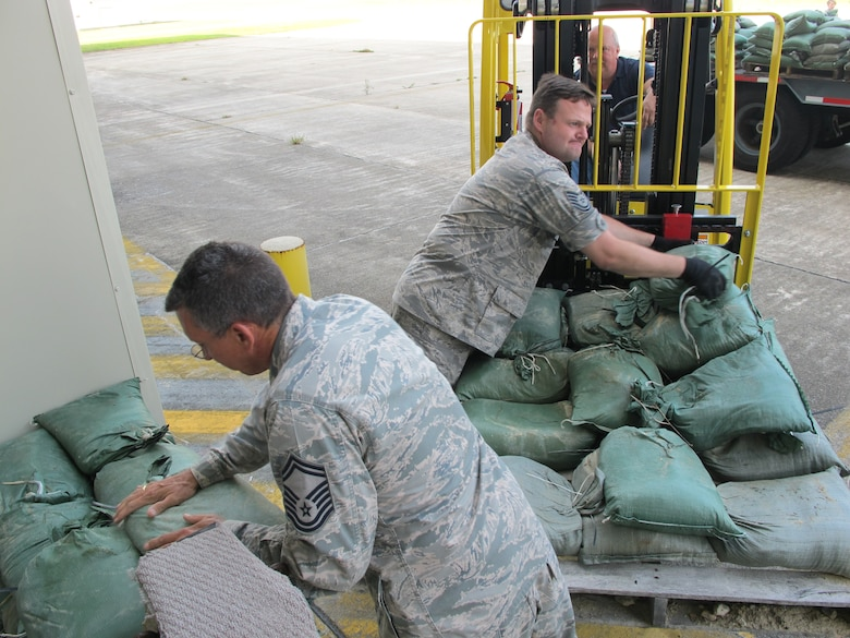 On September 2, 2010 the 102d Intelligence Wing located on Cape Cod began preparing for Hurricane Earl which is expected to reach the Cape and Islands by late Friday. Senior Master Sgt Dale Swartz and Technical Sgt. Brian Savage build a sand bag barrier used to protect buildings from water damage as heavy rains and wind from the storm are expected.