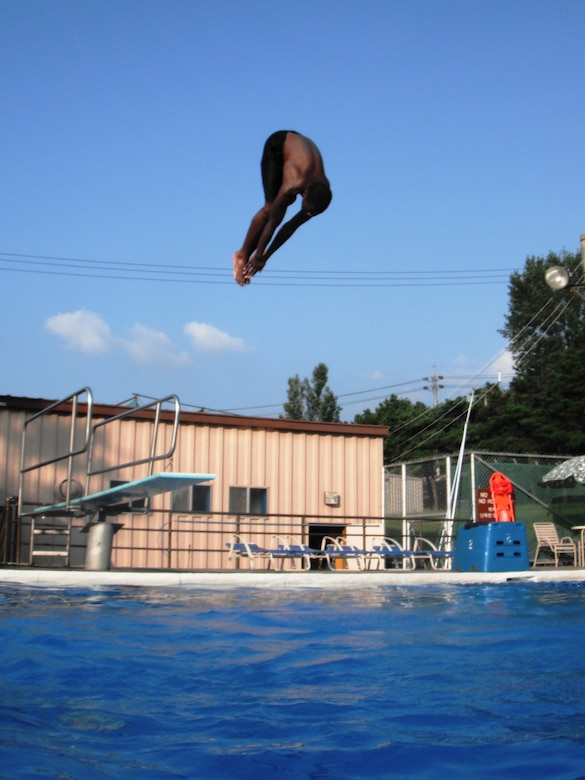 Kenith Isreal dives in at Osan's Defender Pool Sept. 4. The outdoor pool complex remains open through Sept. 7; after that, members of the Team Osan community can swim year-round at the Mustang Indoor Pool. For hours and information, call 784-1452. (U.S. Air Force photo/Staff Sgt. Eric Burks)