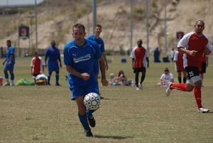 [Randolph Air Force Base soccer team plays other intramural teams from other Air Force bases from across the United States. The games were part of 2010 Defender's Cup held at the South Texas Area Regional Soccer Complex in San Antonio, Texas.  Cody Sanchez of the Randolph team moves the ball toward the Cannon AFB goal. (U.S. Air Force Photo/Brian McGloin)