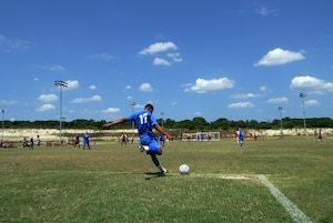 (U.S. Air Force Photo/Brian McGloin)  Randolph Air Force Base soccer team plays other intramural teams from other Air Force bases from across the United States. The games were part of 2010 Defender's Cup held at the South Texas Area Regional Soccer Complex in San Antonio, Texas.  Randolph's Martin Sandino, an Army delayed enlistment program member, returns a failed goal attempt. (U.S. Air Force Photo/Brian McGloin)