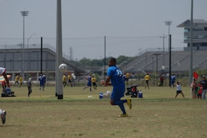 Randolph Air Force Base soccer team plays other intramural teams from other Air Force bases from across the United States. The games were part of 2010 Defender's Cup held at the South Texas Area Regional Soccer Complex in San Antonio, Texas. Alexis Trevor from Randolph prevents a Cannon AFB goal. Randolph beat Cannon 2-0. (U.S. Air Force Photo/Brian McGloin)