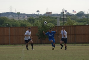 Randolph Air Force Base soccer team plays other intramural teams from other Air Force bases from across the United States. The games were part of 2010 Defender's Cup held at the South Texas Area Regional Soccer Complex in San Antonio, Texas. Zhecho Radevski from Randolph moves the ball toward the Cannon goal. Cannon beat Randolph 2-0. (U.S. Air Force Photo/Brian McGloin)