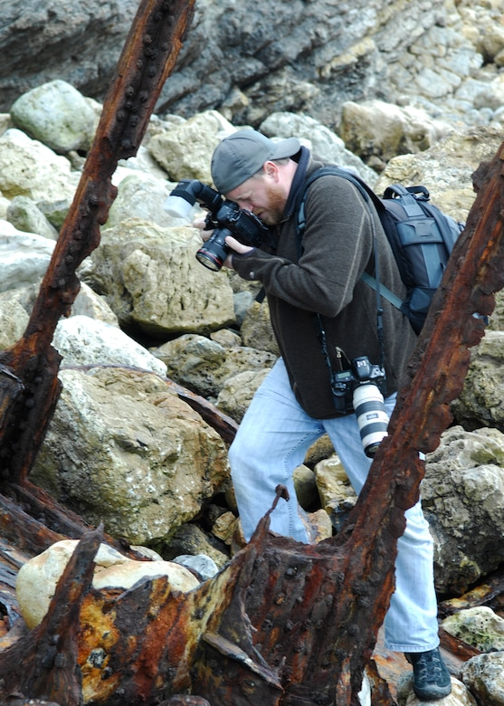 VANDENBERG AIR FORCE BASE, Calif.  -- Hoping to capture the interest of the community, Bryan Walton, a photographer for the Santa Maria Times, photographs wreckage from the crash of U.S.S. Chauncey on the coast of Vandenberg here Friday, Feb. 26, 2010. The crash, which happened in 1923, involved seven Navy destroyers and resulted in 23 deaths. (U.S. Air Force Photo/Senior Airman Heather Shaw)