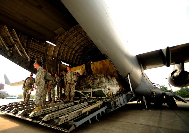 U.S. Army soldiers from the 16th Combat Aviation Brigade, Ft. Wainwright, Ak arrive to Chaklala Air Force Base, Pakistan aboard a C-17 Globemaster III aircraft in support of flood relief efforts on Sept. 1, 2010. The 16th CAB also brought two UH-60 Blackhawk helicopters along with personnel.(U.S. Air Force photo by Staff Sgt. Andy M. Kin / Released)
