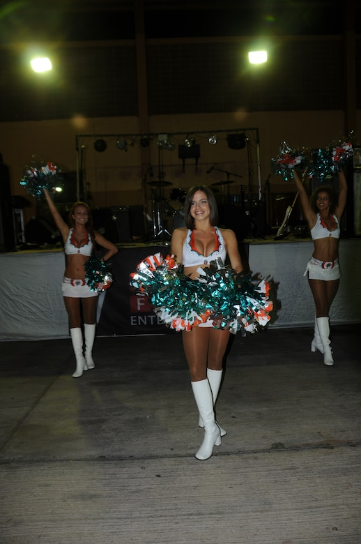 SOTO CANO AIR BASE, Honduras --  Performing a dance routine, the Miami Dolphins cheerleaders entertain Team Bravo during an Armed Forces Entertainment-hosted show here Sept. 2. The cheerleaders performed dance numbers and gave out prizes to audience members after their performance. (U.S. Army photo/Spc. Jennifer Grier)