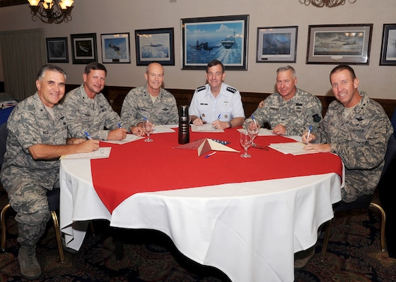 (left to right)  Brig. Gen. William Welch, Air Force Recruiting Service commander; Brig. Gen. Leonard Patrick, 502nd Air Base Wing commander; Maj. Gen. James Whitmore, Air Education and Training Command vice commander; Gen. Stephen Lorenz, AETC commander; Col. Robert S. Bridgford, 502 ABW vice commander and Maj. Gen. Mark Solo, 19th Air Force commander sign pledge cards to kickoff the 2010 Combined Federal Campaign.  Randolph Air Force Base hosted a breakfast at the Parr Club Tuesday to celebrate the event. (U.S. Air Force photo/Melissa Peterson)
