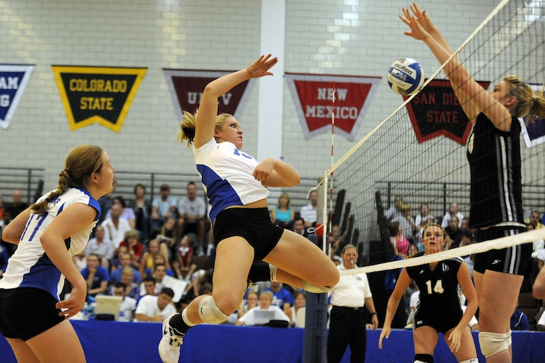 Falcon Caitie Campbell tries to spike the ball over the net during the second game of their season opener against Long Island College Aug. 27, 2010, at the U.S. Air Force Academy in Colorado Springs, Colo. The Falcons won 3-2 over Long Island with scores of 25-14, 22-25, 29-31, 25-19 and 15-9. (U.S. Air Force photo/J. Rachel Spencer)
