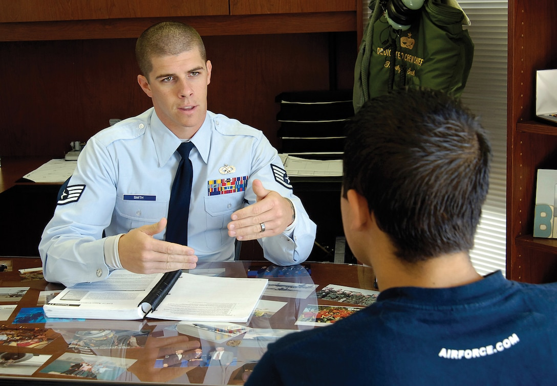 Air Force recruiter Staff Sgt. Timothy Smith Jr. talks with Miles Montoya in the 349th Recruiting Squadron's Norman office. Mr. Montoya is in the Delayed Entry Program and hopes to be a SERE specialist or combat controller, demanding careers with tough entry requirements. Sergeant Smith is helping him toward that goal and works with him several times a month, checking on his physical fitness progress, encouraging and guiding him. (Air Force photo by Margo Wright)
