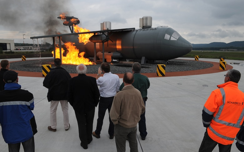 Construction team members and fire trainers view the new aircraft fire training burn site, Ramstein Air Base, Germany, Sept. 9, 2010. The new burn site is the only aircraft training site in Germany and will help train in many aircraft scenarios. (U.S. Air Force photo by Senior Airman Caleb Pierce)