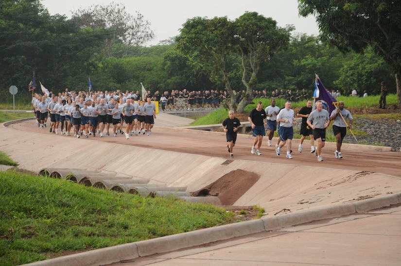SOTO CANO AIR BASE, Honduras --  Team Bravo winds around a base road here during the Joint Task Force-Bravo Run on Sept. 10. The monthly run encourages esprit de corps and physical fitness. (U.S. Air Force photo/Tech. Sgt. Benjamin Rojek)