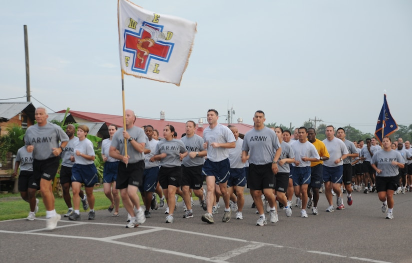 SOTO CANO AIR BASE, Honduras --  Members of the Medical Element follow their guidon bearer during the Joint Task Force-Bravo Run here Sept. 10. (U.S. Air Force photo/Tech. Sgt. Benjamin Rojek)
