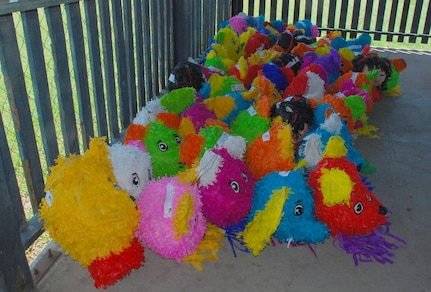 SOTO CANO AIR BASE, Honduras --  Team Bravo members filled up and deliverd piñatas to local school representatives Sept. 8 here. Coordinated by Civil Affairs here, the piñata gifts are in honor of Honduras' Childrens Day, which takes place Sept. 10. (U.S. Air Force photo/Martin Chahin)
