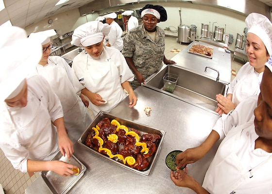 Students prepare the final meal served at the Culinary Arts Training Center Sept. 3. The 345th Training Squadron, along with the CATC, is moving to Fort Lee, Va. (U.S. Air Force photo/Robbin Cresswell)