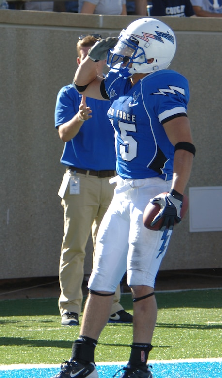 Air Force wide receiver Jonathan Warzeka salutes the crowd at Falcon Stadium after scoring a touchdown against the BYU Cougars Sept. 11, 2010. Warzeka, a second-class cadet and native of Lake Elsinore, Calif., had 62 yards on six carries, including a career-long 46-yard dash for a TD on fourth and 2. (U.S. Air Force photo/Staff Sgt. Raymond Hoy)
