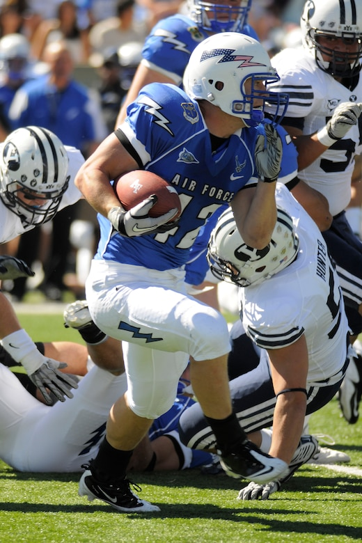 Falcons running back Jared Tew evades a tackle by Cougars linebacker Shane Hunter in Air Force's 35-14 victory over BYU at Falcon Stadium Sept. 11, 2010. Tew, a first-class cadet and native of Park City, Utah, had 77 yards on 17 carries against the Cougars. (U.S. Air Force photo/Bill Evans)