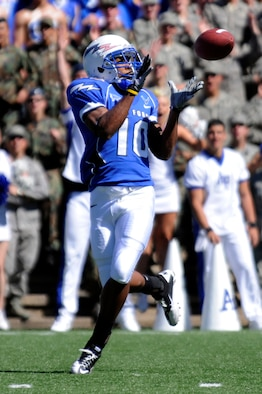 Falcons wide receiver Mikel Hunter pulls in a pass for a touchdown during the Air Force-BYU game at Falcon Stadium Sept. 11, 2010. Hunter, a third-class cadet and native of Conyers, Ga., scored two TDs on the day in the Falcons' 35-14 victory over the Cougars. (U.S. Air Force photo/Mike Kaplan)